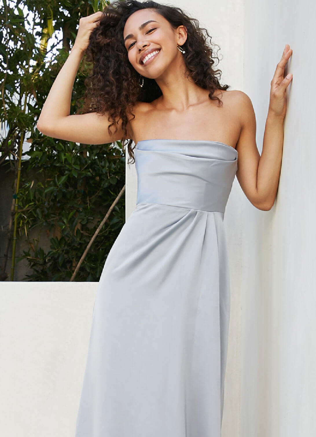 Model wearing a bridesmaids collection gown